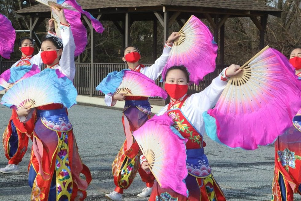 The Chinese American Community Center dancers will use silk fans, flower balls and a dragon to perform.