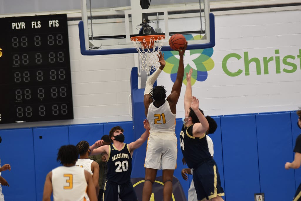 Nnanna Njoku goes up for a score against Salesianum.