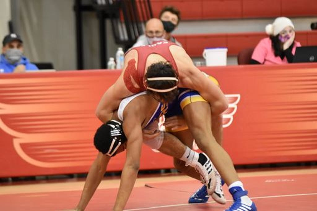 Nathan Lesniczak. in red, got one of the Smyrna's pins that powered their win against Caesar Rodney.