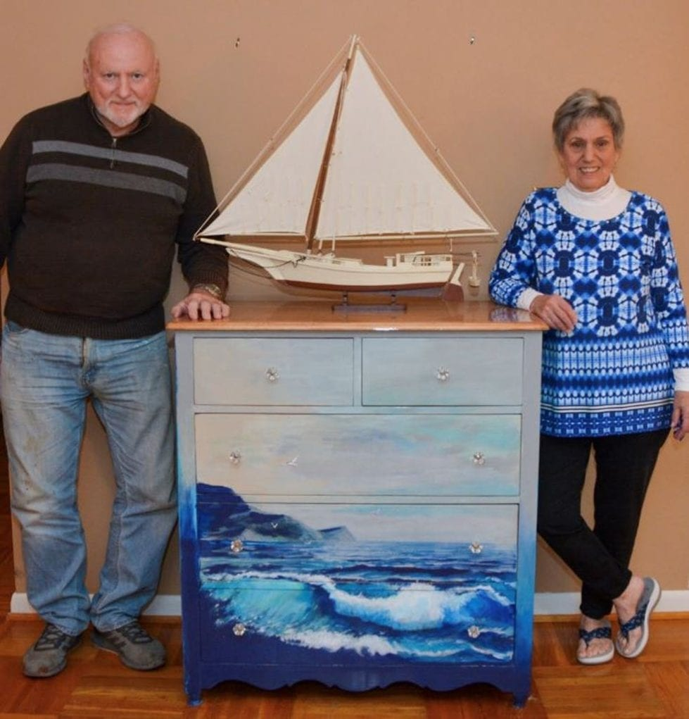 Jerry Becker, a retired Concord High art teacher, and Ruth Govatos show off their sea wave chest.