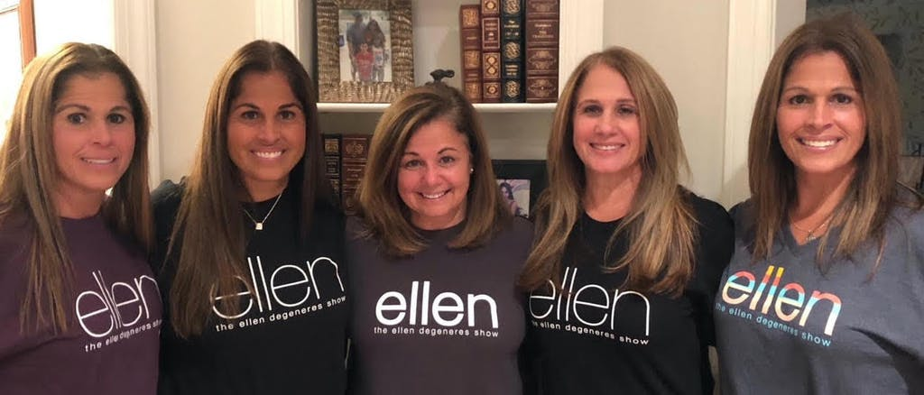 The sisters in some of the T-shirts that they purchased as souvenirs.