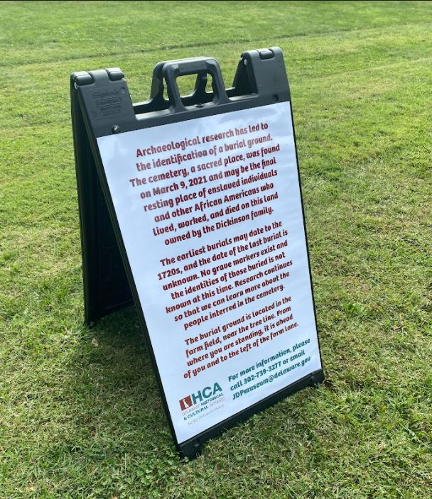 a sign on a grassy field
